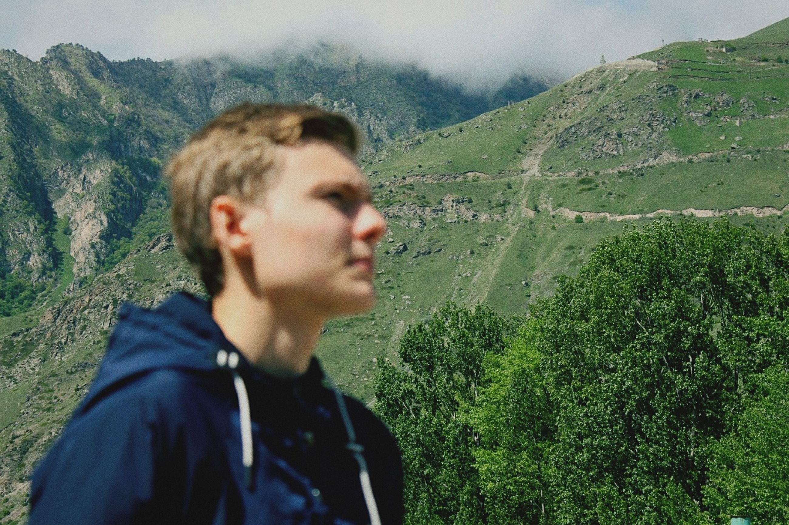 mountain, nature, real people, scenics, one person, young men, day, beauty in nature, young adult, outdoors, lifestyles, landscape, mountain range, hiking, tree, adventure, leisure activity, sky, people