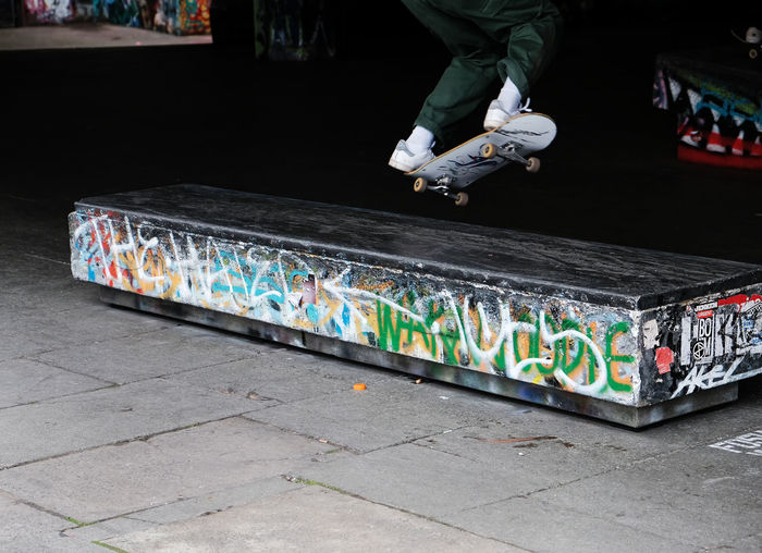 Low section of man skateboarding on skateboard