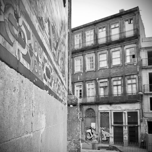 BeW Oporto, Portugal Architecture Black And White Building Building Exterior Built Structure City Communication Day Low Angle View Nature No People Old Outdoors Reflection Residential District Sky Street Text Wall Wall - Building Feature Window