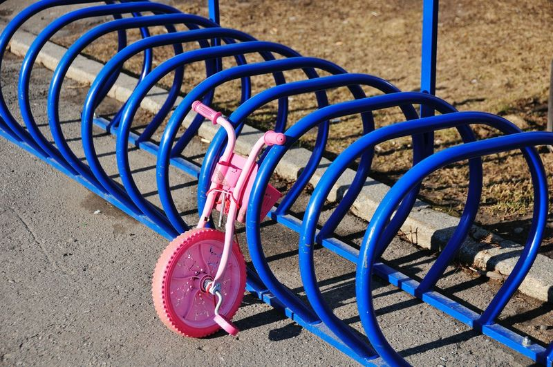 Abandoned Tricycle By Rack