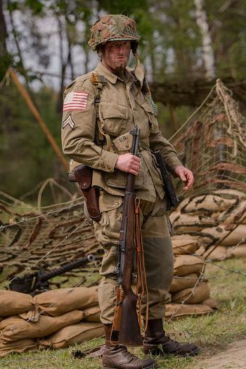 Airborne Casual Clothing Day Focus On Foreground Gun Headwear Helmet Leisure Activity Lifestyles Man Men Military Nature Outdoors Paratrooper War Wii