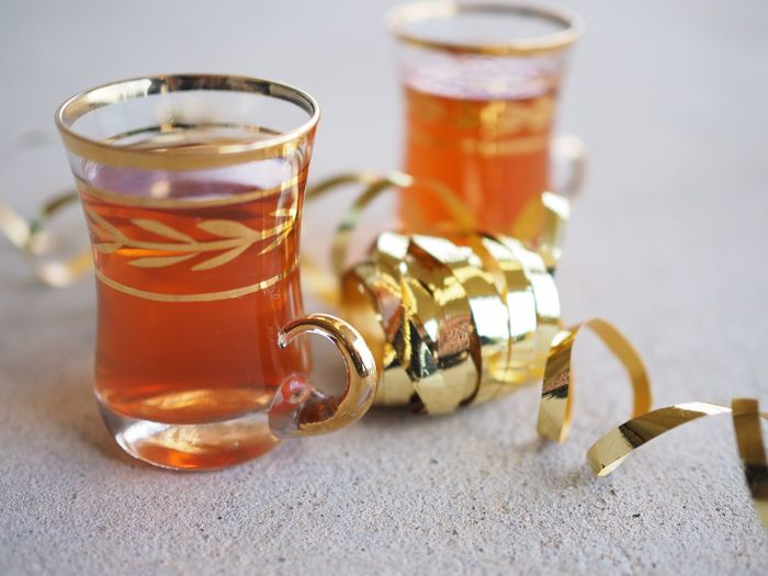 Close-up of herbal tea with ribbon on table