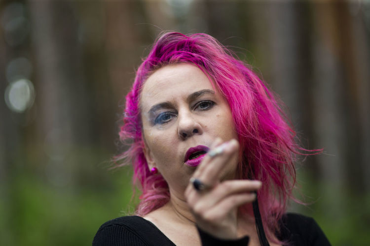 Portrait of beautiful young woman with pink hair