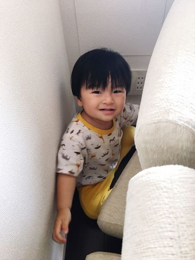 he likes narrow spaces:) Like Narrow Space Indoors  One Person Childhood Smiling Toddler  Happiness Looking At Camera Mysweetbaby