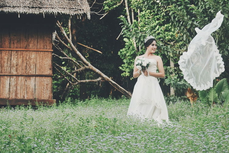 Bride Standing On Field