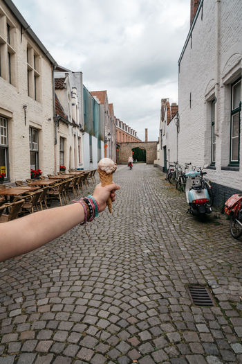 Woman hand holding and ice cream cone against medieval city background Architecture Building Exterior City Cobblestone Day Follow Followme Fun Girl Human Hand Ice Cream Ice Cream Cone Ice Cream Time Lifestyle One Person Outdoors People Real People Street Summer Summertime Tasty Urban Vacations Neighborhood Map