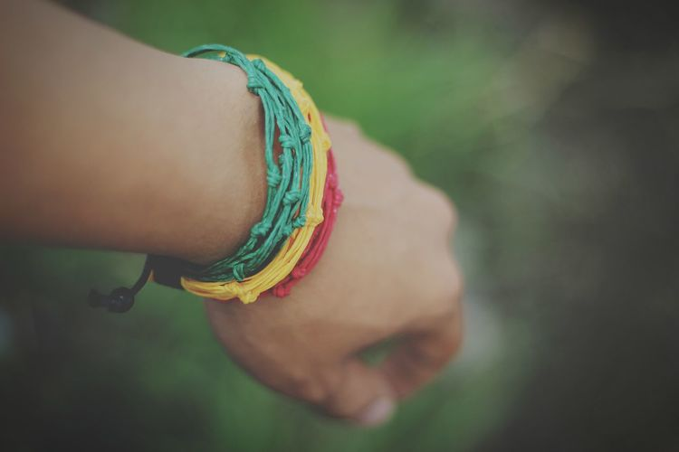 Cropped Hand With Colorful Bracelets