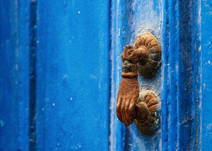 Rusty handle on metal door