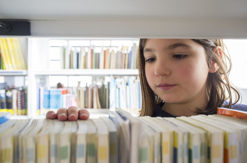 Portrait of girl looking at book