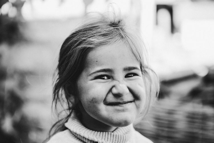 Close-up portrait of smiling innocent girl