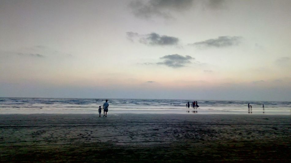 Beach Sea Water Sand Horizon Over Water Sky Cloud - Sky Silhouette Tranquility Nature Summer Beauty In Nature Sunset Full Length Scenics People Outdoors Wave Beauty Day Clouds And Sky Skylovers Bikeride Biker Traveller Live For The Story The Street Photographer - 2017 EyeEm Awards The Photojournalist - 2017 EyeEm Awards