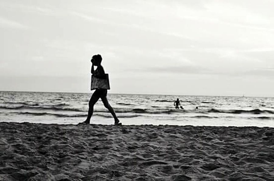 Anima latina. Beach Sea Sand Full Length Real People People Outdoors Vacations Horizon Over Water Childhood Cloud - Sky Day Adult Sky Undergroundphotography Black & White Blackandwhite Photography One Person Stranger