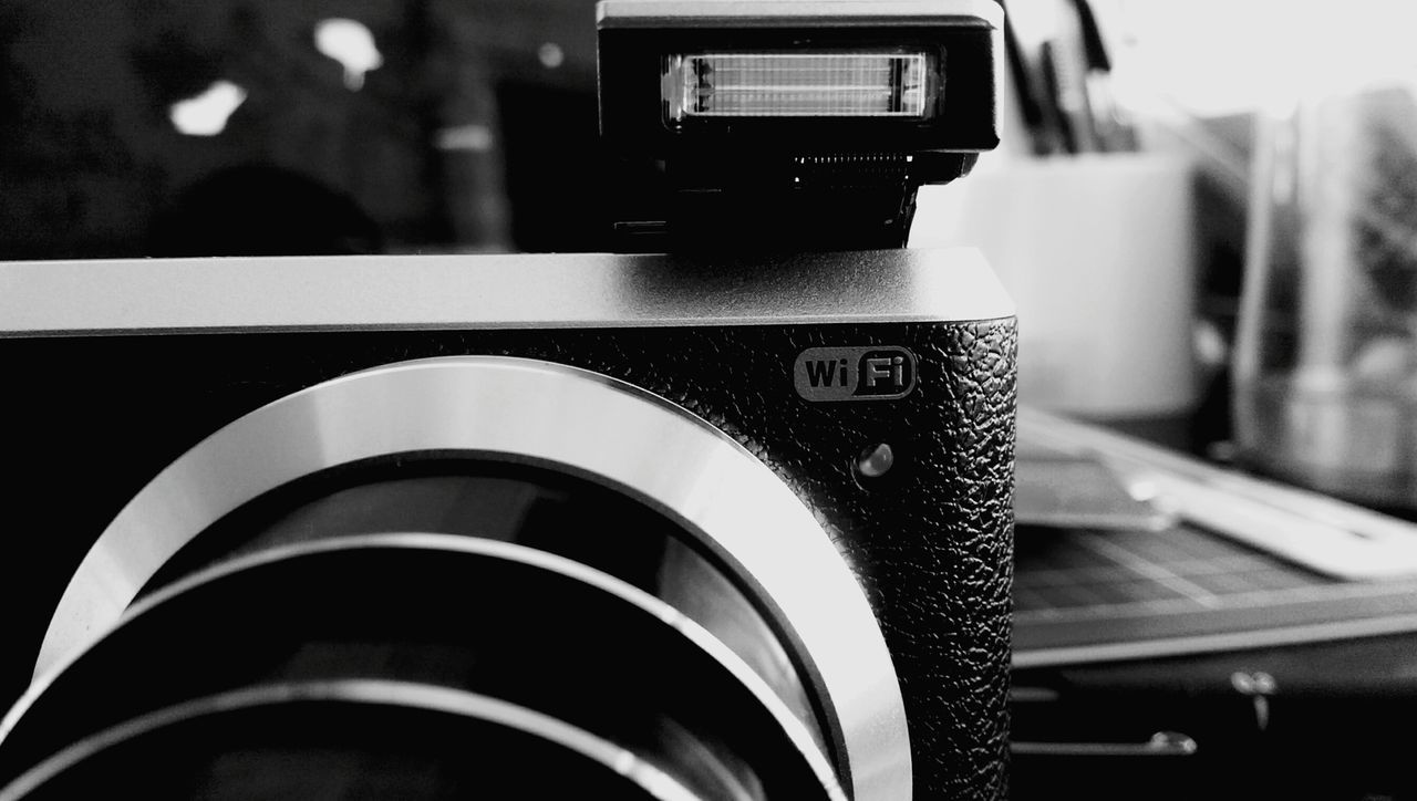 technology, camera - photographic equipment, photography themes, focus on foreground, control, indoors, camera, close-up, no people, photographing, modern, wireless technology, day, digital single-lens reflex camera