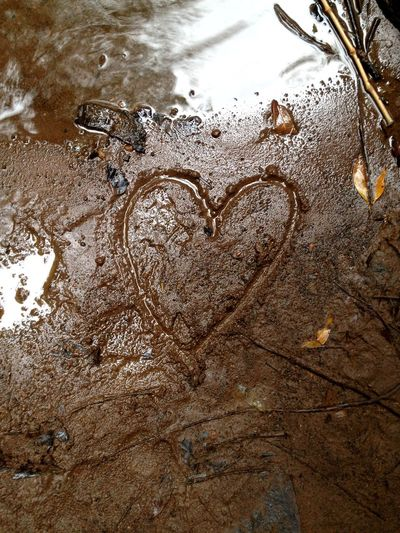 Heart Shaped Scrawl Brotas, SP - Brasil Waterfall Water High Angle View No People Wet Day Reflection Nature Heart Shape Outdoors Creativity Positive Emotion Love Land Nature Love Close-up Reflection Emotion Land Textured