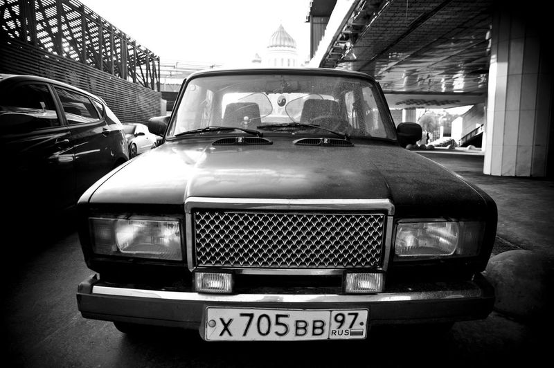 EyeEmNewHere Moscow Russia Stories From The City Architecture Black Black And White Blackandwhite Blackandwhite Photography Blakck And White Building Exterior Built Structure Car City Day Land Vehicle No People Old Car Old-fashioned Outdoors Streetphotography Transportation