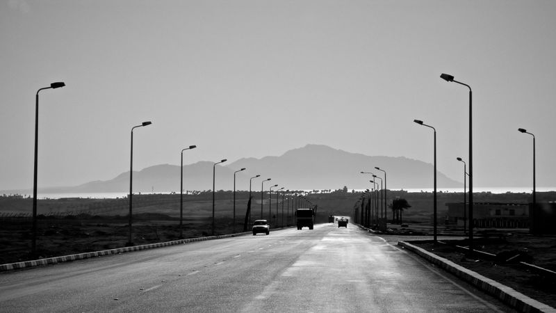 view on tiran island from the street of sharm el sheikh Blackandwhite Photography Nature No People Outdoors Road Street Light Street Photography Tiran Island Transportation Travel Pictures
