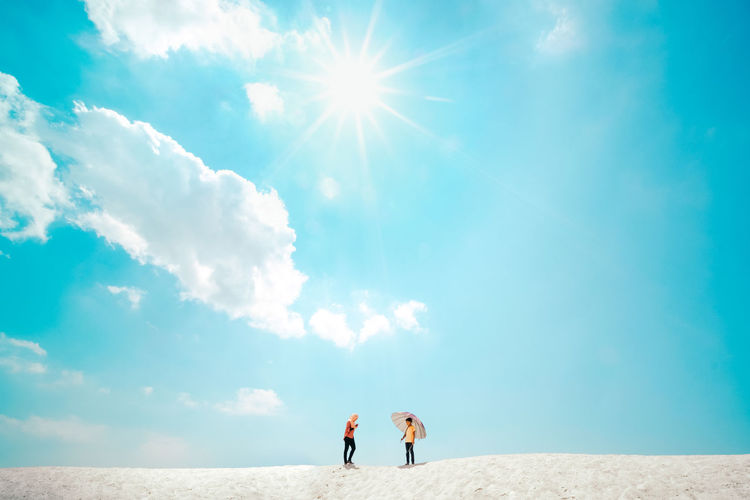Klebang Sand Dunes, Melaka, Malaysia Sky Cloud - Sky Lifestyles Leisure Activity Day Togetherness Two People Sunlight Nature Scenics - Nature Sunny Sun Lens Flare Bright People Beauty In Nature White Sand Blue Sky Travel Umbrella Copy Space Hot Weather Heat Desert