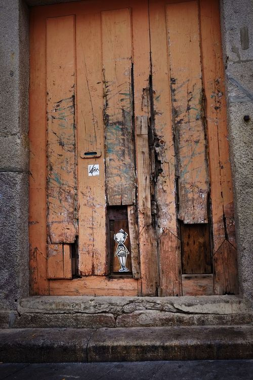 Small graffiti of a door Architecture Built Structure Building Exterior Building No People Entrance Door Weathered Abandoned Closed Old Outdoors Day