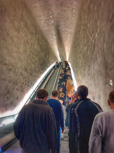 Up and away Group Of People Men Transportation Mode Of Transportation Real People Architecture Indoors  People Women Lifestyles Rear View Adult Travel Crowd Subway Leisure Activity Illuminated Tunnel Casual Clothing Ceiling