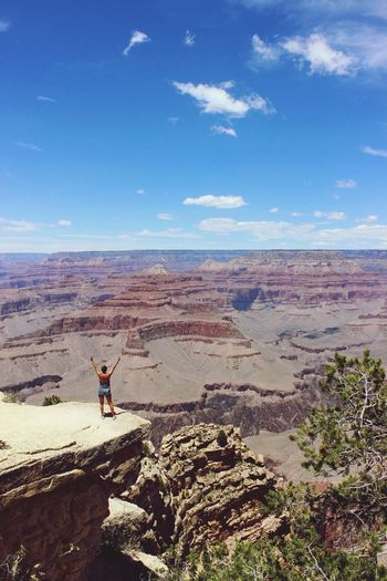 Person standing on rock formation