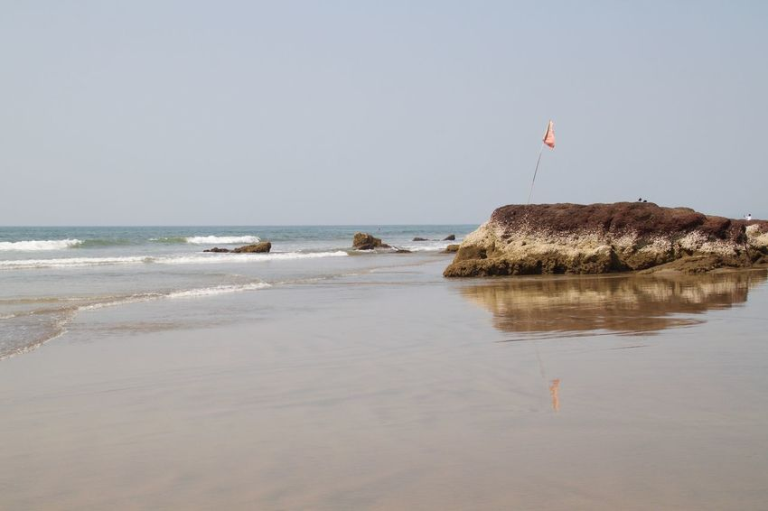 Ashvem Ashvem Beach Beach Beach Life Beach Photography Beauty In Nature Day Flag Goa Horizon Over Water Nature No People Outdoors Sea Seaside Tranquility Water Wave