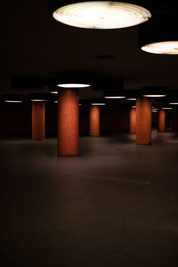 Interior of illuminated empty parking lot