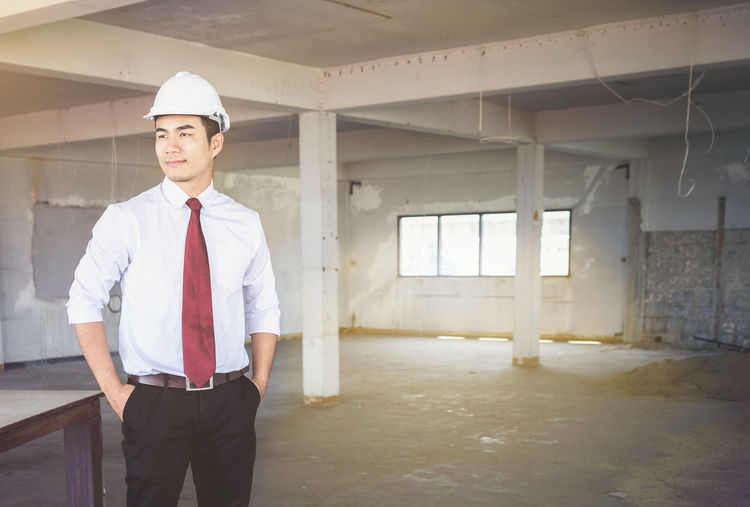 Portrait of architect standing at construction site