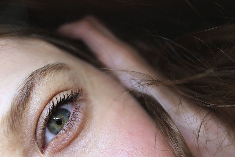 Close-up of woman with hazel eye