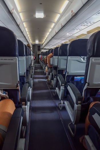 Travel Transportation Passenger Vehicle Seat Airplane Adult Air Vehicle Airplane Seat Flying Commercial Airplane Adventure Packed Up Summer Travel Traveling Vacation Traveler Airplane Seat Airplanes Aisle Aisle Seat Seating EyeEm Selects Let's Go. Together.