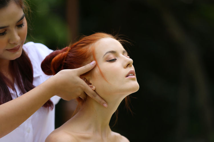 women on spa treatment and beautiful bady massaging Dyed Red Hair Hairstyle Teenager Beautiful Woman Beauty Girls Hair Front View People Two People Adult Leisure Activity Focus On Foreground Looking Redhead Portrait Lifestyles Headshot Real People Togetherness Young Women Women Young Adult Females