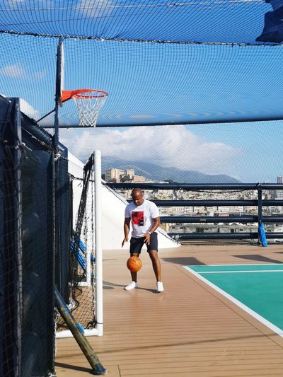 Man playing basketball on cruise ship
