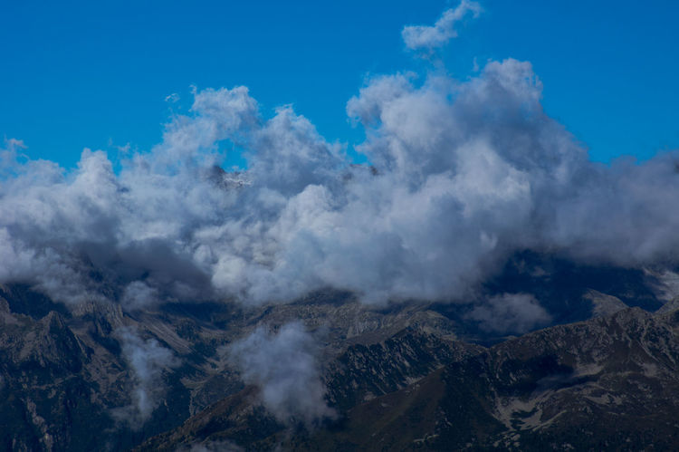Rocks behind the curtain of clouds Alps Beautiful Nature Beauty In Nature Blue Sky Brenta Clouds Cloudy Mountain Peaks Dolomites Dolomites, Italy Dolomiti Europe European Alps Hills Horizontal Landscape Mountain Range Mountains National Park On Top Of Outdoors Ridge Rocks Scenics Summer Wilderness Area