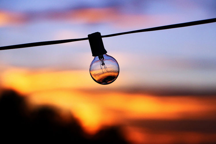 Sunset. Close-up Hanging No People Sunset Outdoors Sky Nature Low Angle View Lightbulb