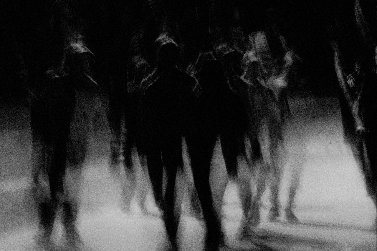 group of people, real people, blurred motion, motion, crowd, women, lifestyles, walking, men, adult, large group of people, group, night, city, leisure activity, defocused, street, arts culture and entertainment, nightlife