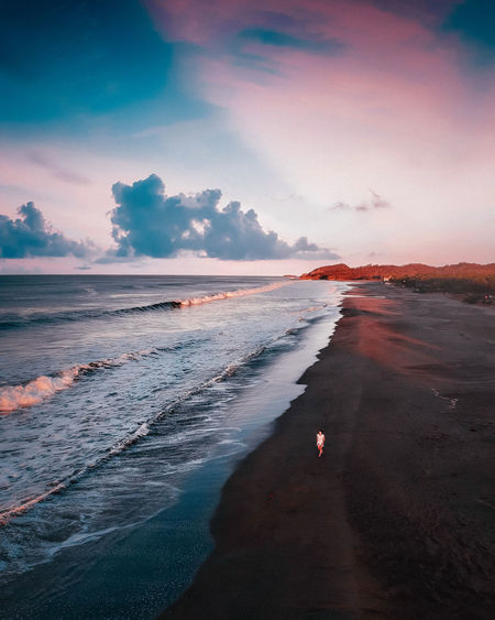 Water Sea Land Beach Sky Cloud - Sky Beauty In Nature Sunset Scenics - Nature Nature Wave People Surfing Real People Motion Power In Nature Outdoors Drone  Dronephotography Aerial View Aerial Aerial Shot Dji Travel Destinations Traveling