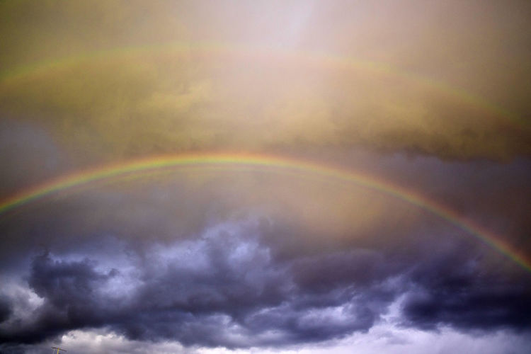 Beauty In Nature Cloud - Sky Sky Scenics - Nature Rainbow Nature Idyllic Tranquility Multi Colored No People Double Rainbow Low Angle View Tranquil Scene Day Outdoors Dramatic Sky Natural Phenomenon Cloudscape Overcast Meteorology