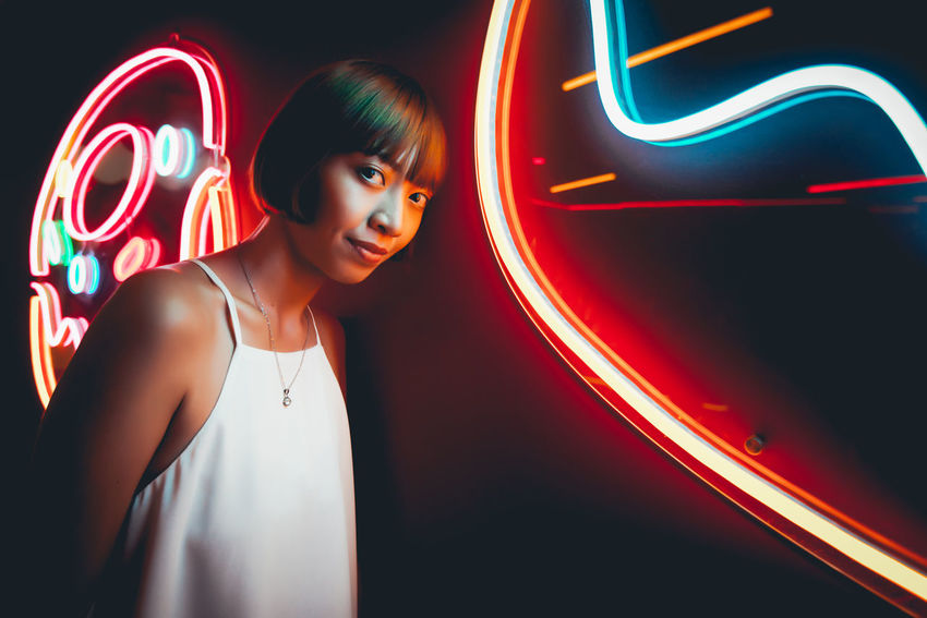 Adult Arts Culture And Entertainment Beautiful Woman Black Background Front View Glowing Hair Hairstyle Illuminated Indoors  Looking Neon Night Nightlife One Person Portrait Standing Waist Up Young Adult