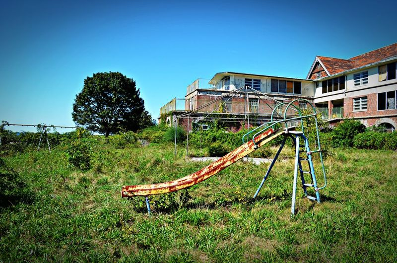 Abandoned Places Built Structure Clear Sky Deterioration Grass No People Run-down