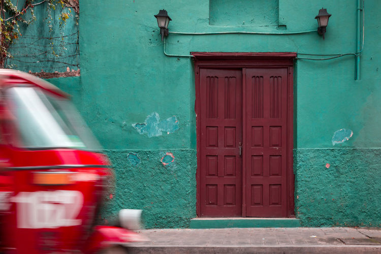 typical Guatemala Guatemala TukTuk Architecture Building Building Exterior Built Structure City Closed Day Door Entrance Flores Green Color House No People Outdoors Protection Red Residential District Safety Security Transportation Turquoise Colored