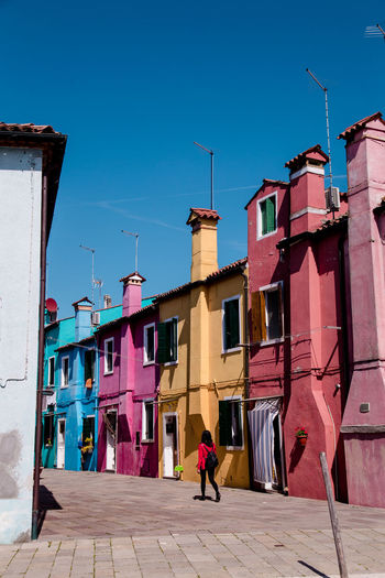 standing out even in Burano Street Burano Burano, Italy Colors Colorful Colours Rainbow Colors Town City Full Length Clear Sky Sunny Sky Architecture Building Exterior Built Structure Place Urban The Architect - 2018 EyeEm Awards Love Is Love