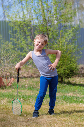 Full length of a girl playing on grassland
