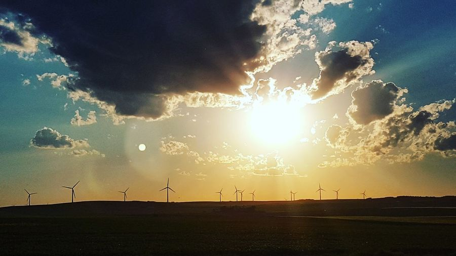 Dramatic Sky Sunset Cloud - Sky Sky No People Nature Outdoors Awe Storm Cloud Beauty In Nature Night Tree Wind Power Wind Turbine Windmill Silhouette Windmill Fields