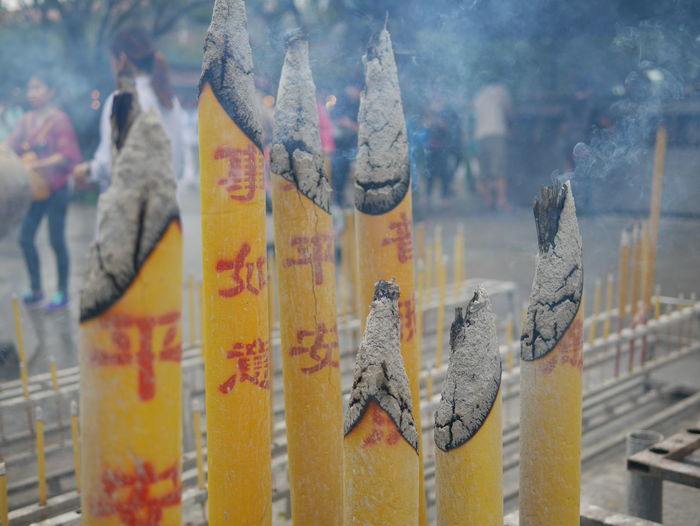 Close-Up On Incense Sticks Burning At Temple