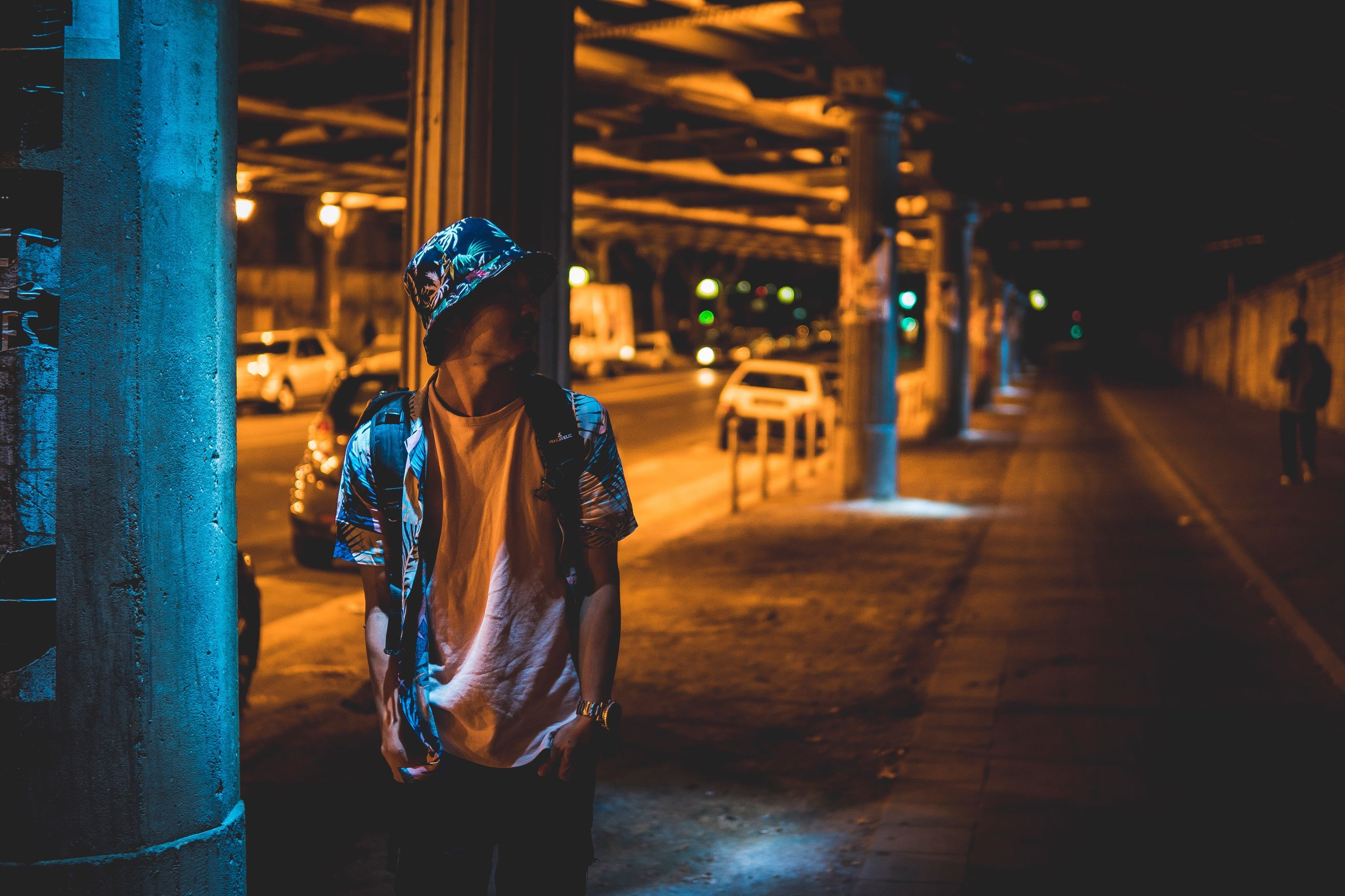 night, real people, illuminated, walking, one person, lifestyles, outdoors, built structure, architecture, standing, men, building exterior, warm clothing, city, young adult, people