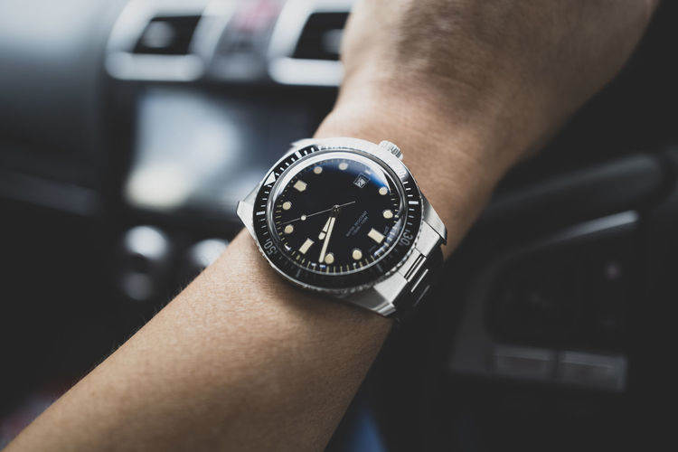 Human Hand Hand Human Body Part Watch Wristwatch One Person Time Close-up Real People Transportation Body Part Focus On Foreground Men Indoors  Personal Perspective Car Mode Of Transportation Travel Motor Vehicle Human Limb Personal Accessory Human Arm Finger
