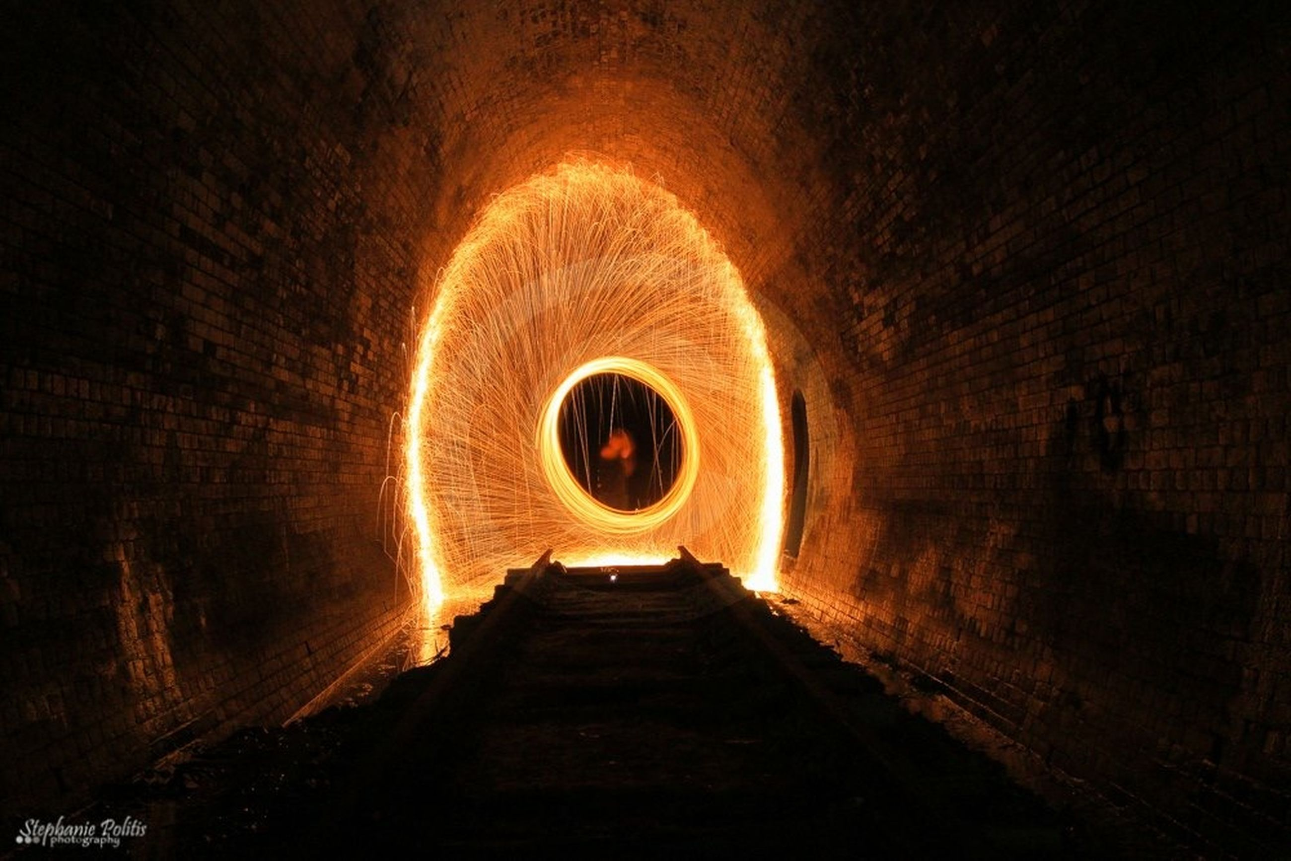 tunnel, the way forward, illuminated, indoors, arch, diminishing perspective, vanishing point, lighting equipment, built structure, architecture, night, light at the end of the tunnel, ceiling, light - natural phenomenon, wall - building feature, transportation, no people, electric light, empty, archway