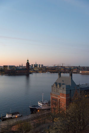 The sun has just dipped below the horizon and left stockholm in a nice colorful glow. Architecture Building Exterior Built Structure City Cityscape Clear Sky Day High Angle View Illuminated Nature Nautical Vessel No People Outdoors River Sky Sunset Travel Destinations Urban Skyline Water