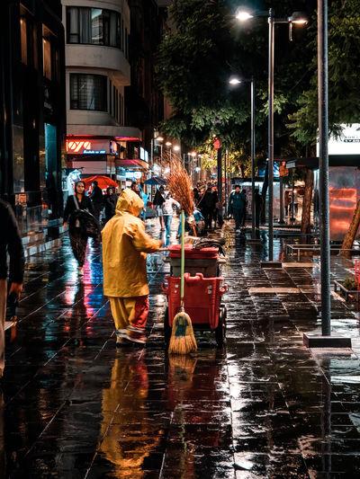 Wet street at night during rainy season