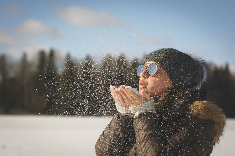 Freezing Portrait Of A Woman Sweden Swedish Nature Close-up Cold Temperature Day Enjoying Life Focus On Foreground Lifestyles Midsection Nature One Person Outdoors Portrait Portrait Photography Real People Sky Snow Warm Clothing Winter