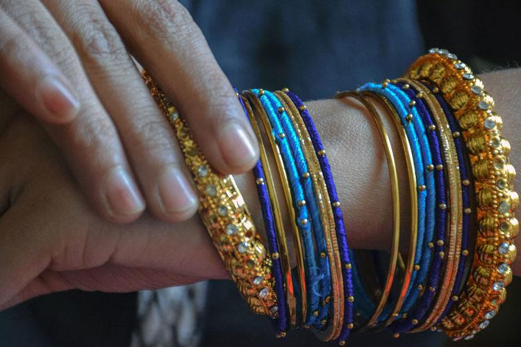 Close-up of woman wearing bangles